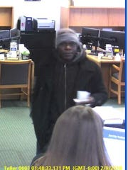 The man in the picture robbed Tri-City National Bank,
