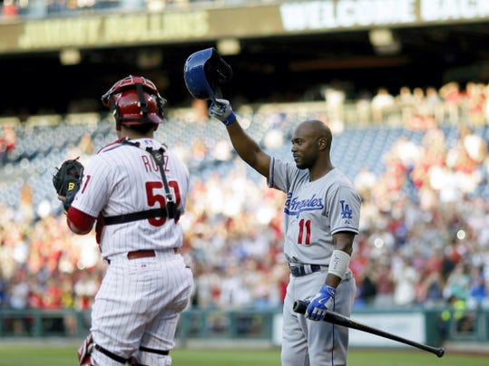 Los Angeles shortstop Jimmy Rollins, right, a former Philadelphia Phillie, acknowledges the crowd before his at-bat in the first inning on Tuesday at Citizens Bank Park. Phillies catcher Carlos Ruiz looks on.