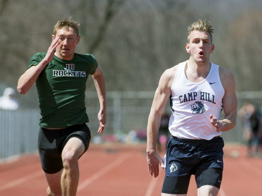 JOHN WHITEHEAD — FOR GAMETIMEPA.COM Andrew Snyder, right, of Camp Hill edges out Peter Hughey of James Buchanan in the boys 100-meter dash at the Arctic Blast Invitational on Saturday at Northern York. Snyder won with a time of 11.03. Hughey later placed first in the 400.