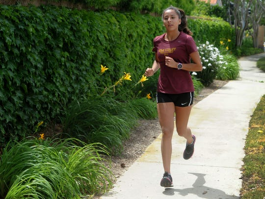 Samantha Barajas, senior at Simi Valley High School goes on her 4-mile run. She's one of the top distance runners in Ventura County, having also shined in cross country.