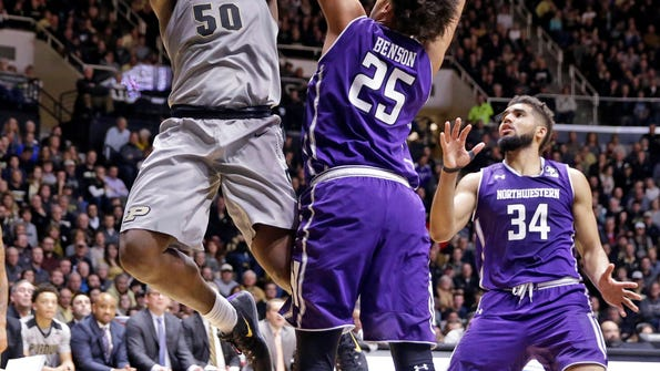 Purdue forward Caleb Swanigan (50) shoots over Northwestern center Barret Benson (25) during the second half of an NCAA college basketball game in West Lafayette, Ind., Wednesday, Feb. 1, 2017. Purdue defeated Northwestern 80-59. (AP Photo/Michael Conroy)
