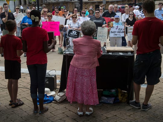 About 65 people showed up to oppose abortion and federal funding of Planned Parenthood at Nashville's Public Square Park on Tuesday.