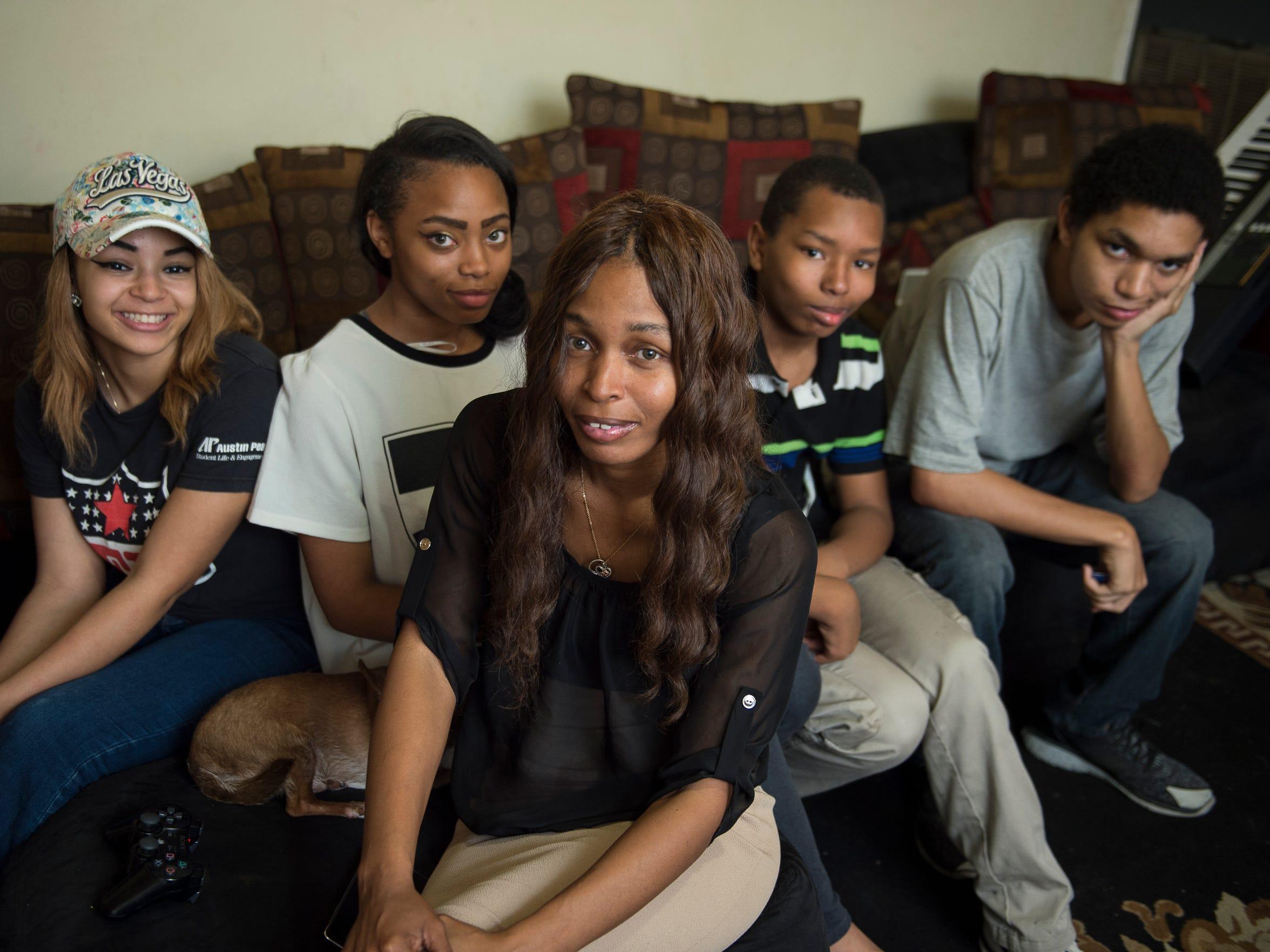 LaConya Hampton with her children Tatiana Parham 17,