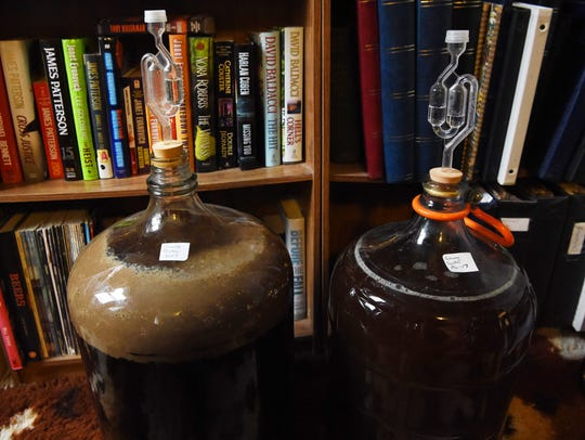 Two carboys of beer busy fermenting in Manny Holl's
