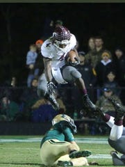 Tony Brown leaps over Poplarville defenders in East
