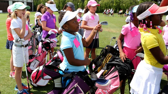 Unique Hicks, 6, of White Plains takes out her club at the Girls to the Tee event put on by the Women's Metropolitan Golf Association at Westchester Country Club in Rye, Aug. 8, 2016. The free clinic, for girls ages 6-18, is an afternoon of instruction and networking to help show girls who are learning the game that they are part of a larger group.