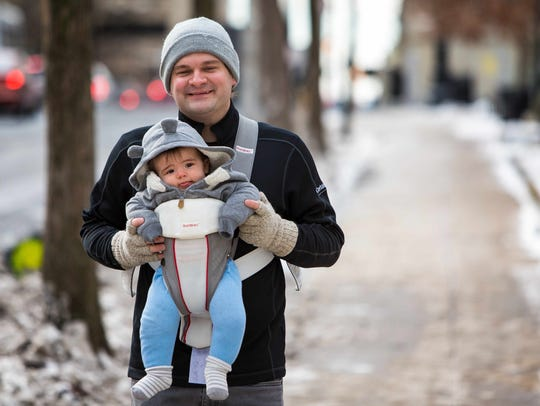Ted Jacoby and his 7-month-old son Max hurry to the