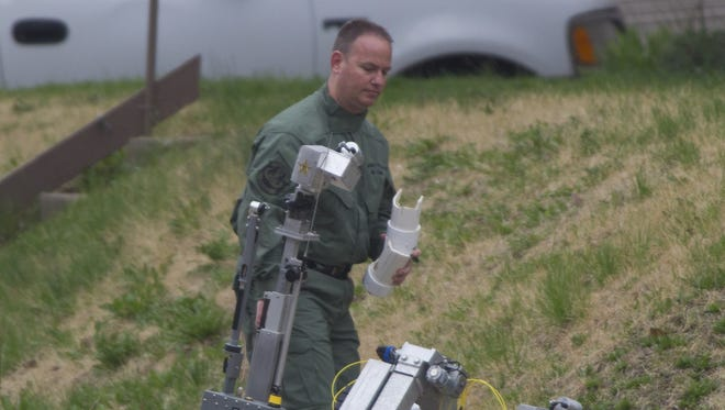 In this 2013 file photo, Tippecanoe County sheriff's Lt. Jason Huber responds to a bomb squad call. Huber will become the community corrections director on Oct. 3