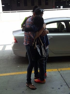 Christopher and his mother, Jenny Ponce, are reunited Friday.