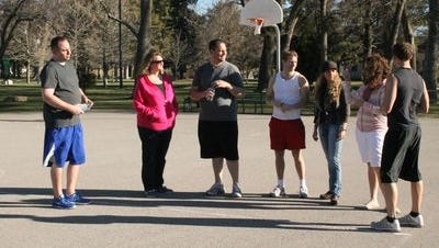 The wives stop by while the men play basketball to give them water. 'My Husband's Not Gay' premieres January 11 at 10/9c on TLC.