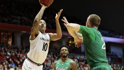 Troy Caupain (10) entered Saturday with 1,077 career points, which was 41st on the University of Cincinnati's all-time scoring list.