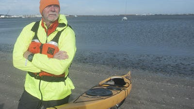 Denis Carmody stands next to his kayak in Cape May. Carmody a former Haddonfield firefighter, is training for a 444-mile kayaking solo expedition in May where he'll go from Lake Otsego in New York to Havre de Grace, Maryland, to raise funds and awareness for veterans who are battling Parkinson's disease.