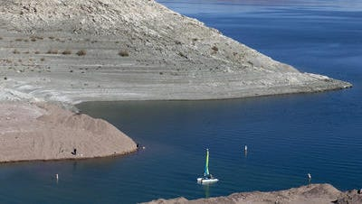 """A high-water mark or """"bathtub ring"""" is visible on the shoreline of Lake Mead."""