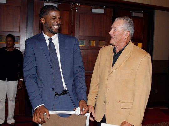 Inductee Marcus Taylor, left, laughs with his former