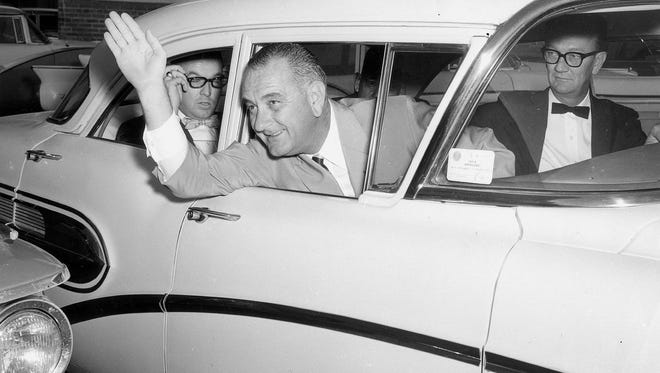 On Nov. 5, 1959, Lyndon Johnson waves as he leaves the Driscoll Hotel for Kingsville, where he addressed students at what was then Texas A&I. Johnson, the Senate majority leader, spent two days making speeches around the Coastal Bend. On the trip he denied having any interest in running for president.