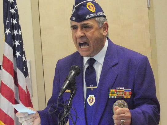 Marco Polo Smigliani, a Purple Heart veteran, speaks
