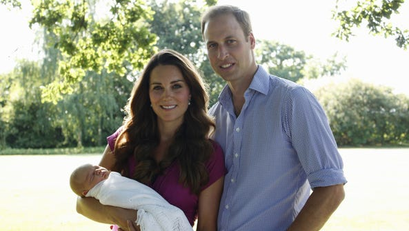 Prince William, Duke of Cambridge, his wife Catherine, Duchess of Cambridge pose with their newborn baby boy, Prince George of Cambridge, at the Middleton family home in Bucklebury, Berkshire in early August.