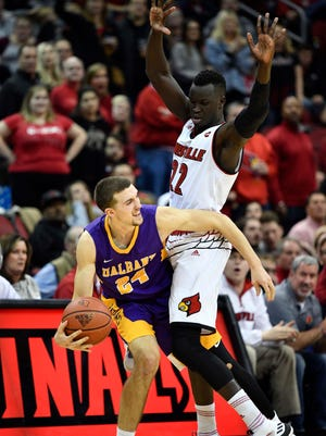 Dec 20, 2017; Louisville, KY, USA; Albany Great Danes guard Joe Cremo (24) looks to pass the ball defended by Louisville Cardinals forward Deng Adel (22) during the second half at KFC Yum! Center. Louisville defeated Albany 70-68.  Mandatory Credit: Jamie Rhodes-USA TODAY Sports