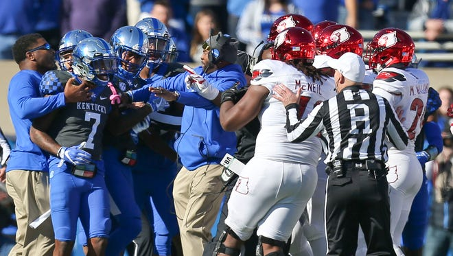 Kentucky and Louisville scuffled and fought after UK linebacker Jordan Jones and U of L quarterback Lamar Jackson exchanged shoves near the goal line in the first quarter of their 2017 showdown.