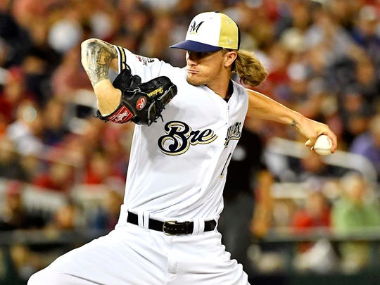 Josh Hader of the Brewers pitches in the eighth inning.