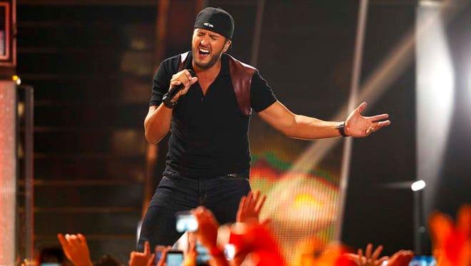 Luke Bryan performs at the CMT Music Awards at Bridgestone Arena on Wednesday, June 10, 2015, in Nashville, Tenn.