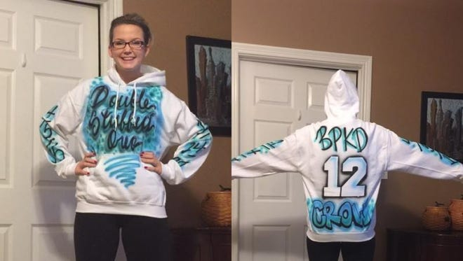 Hausfeld wearing the new sweatshirt replaced for free by an airbrush store in Tri-County Mall.