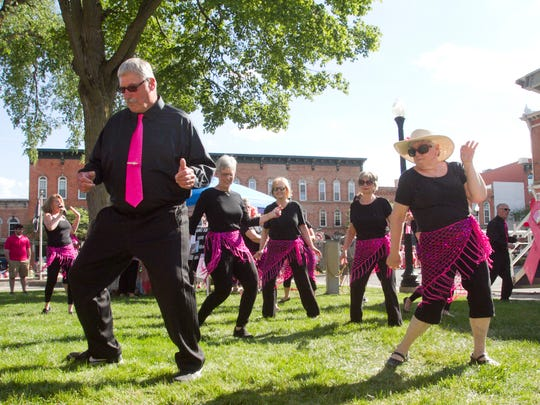 Robert Chickowski, wearing a bright pink tie and making all the right moves, catches the attention of the rest of the Senior Advanced Fitness group dancing Thursday, June 8, 2017 at the annual Pink Party. The 2020 event was cancelled due to the novel coronavirus.