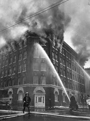The former Newell & Truesdell building on fire, around 1960.