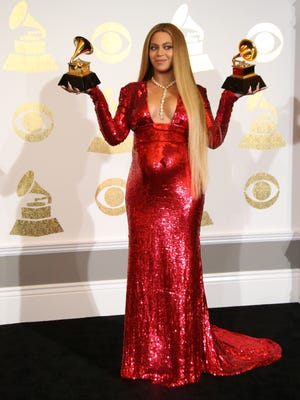 Beyonce Knowles poses with her twin Grammys in the photo room.  She won Grammys for Best Urban Contemporary Album and Best Music Video.
