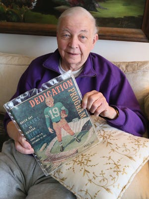 Former Milwaukee Sentinel sportswriter/columnist Bud Lea holds his copy of the Dedication Program for the first game in what would be later called Lambeau Field but was then City Stadium.