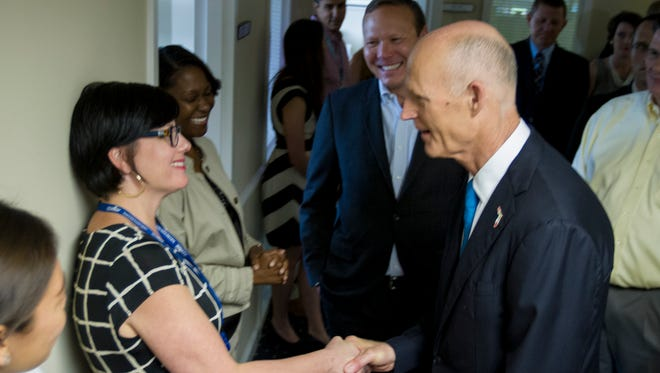 Gov. Rick Scott greets staffers at AppRiver in Gulf Breeze. Scott visited the information technology company on Wednesday to highlight job growth in the state.