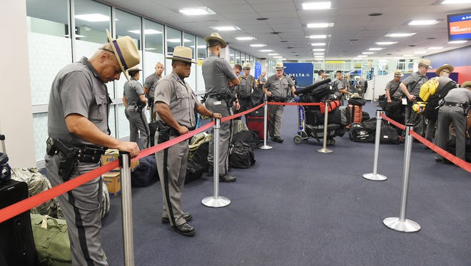 On the orders of Gov. Andrew M. Cuomo, 50 New York State Troopers and 10 New York Power Authority workers check in early Friday morning at John F. Kennedy International Airport on a Delta Airlines humanitarian flight to San Juan, Puerto Rico to help in the aftermath of Hurricane Maria.