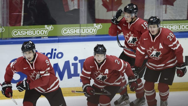 (L to R) Canada's players Dylan Strome, Joe Hicketts, Jake Virtanen and Lawson Crouse celebrate Strome's 2-1 goal during the 2016 IIHF World Junior U20 Ice Hockey Championships tournament match Switzerland vs Canada in Helsinki, Finland on December 29, 2015.