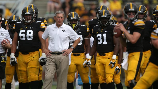 Iowa head football coach Kirk Ferentz looks on as his Hawkeyes warm up before playing Northern Iowa on Saturday, Aug. 30, 2014, at Kinnick Stadium in Iowa City, Iowa.