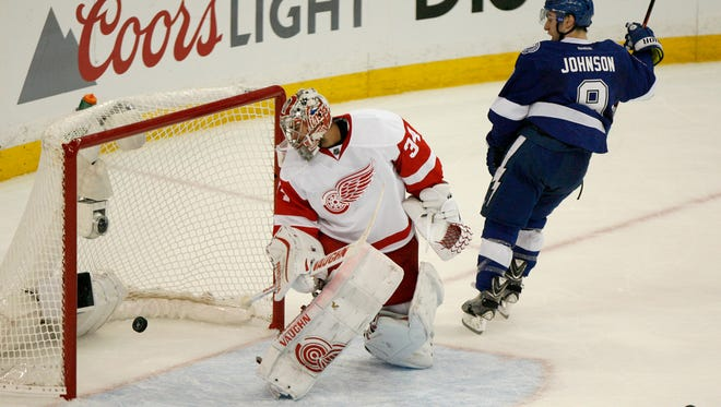 Tampa Bay Lightning center Tyler Johnson (9) celebrates after scoring past Detroit Red Wings goalie Petr Mrazek (34) during the second period in Game 2 in the first round of the NHL hockey Stanley Cup playoffs, Saturday, April 18, 2015, in Tampa, Fla.