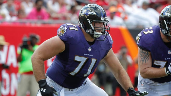 Baltimore Ravens tackle Ricky Wagner blocks against the Tampa Bay Buccaneers on Oct. 12, 2014, at Raymond James Stadium.