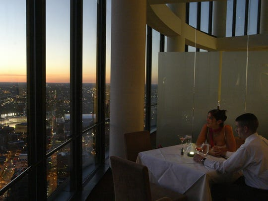Lindsay Cachia of Brownstown and Chris Wilkes of Wyandotte have dinner at Coach Insignia on top of the Renaissance Center on Saturday, July 2, 2005. The restaurant closed in 2017 and will be replaced by a new restaurant from James Beard Award-winning chef Shawn McClain.