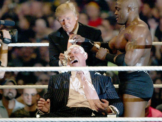 Donald Trump and Bobby Lashley shave the head of Vince McMahon after the Battle of the Billionaires at WrestleMania 23 at Ford Field in April 2007.