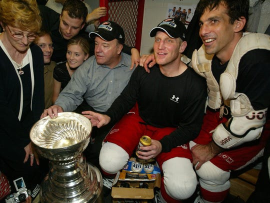 Scotty Bowman, Brett Hull and Chris Chelios in the