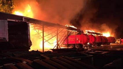 Nine fire departments fought a large fire at Ray's Trash Service off U.S. 40 in Clayton, Ind., early Tuesday morning.