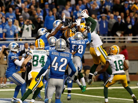 Green Bay's Richard Rodgers reaches up for the ball