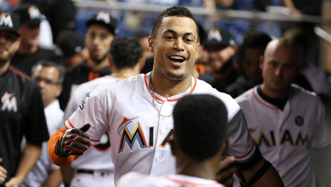 The Miami Marlins' Giancarlo Stanton has been hitting lots of home runs recently.