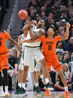 Michigan State's Nick Ward and Bucknell's Avi Toomer battle for a loose ball during the early minutes of the game.