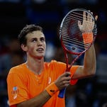 Vasek Pospisil of Canada celebrates his win against Richard Gasquet of France on Tuesday at the Shanghai Rolex Masters.