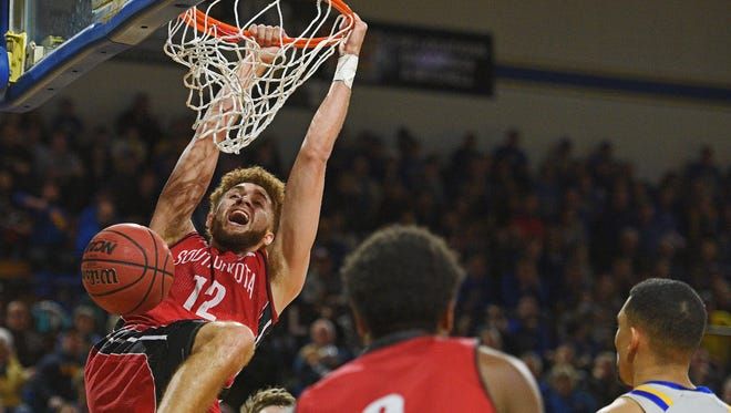 USD's Trey Burch-Manning (12) dunks the ball during a game against SDSU Saturday, Dec. 31, 2016, at Frost Arena on the South Dakota State University campus in Brookings, S.D. The Jackrabbits beat the Coyotes 73-72.