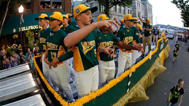 The Midwest team from Sioux Falls rides in the Little League Grand Slam Parade in downtown Williamsport, Pa., Wednesday, Aug. 16, 2017. The Little League World Series baseball tournament gets underway Thursday in South Williamsport, Pa.