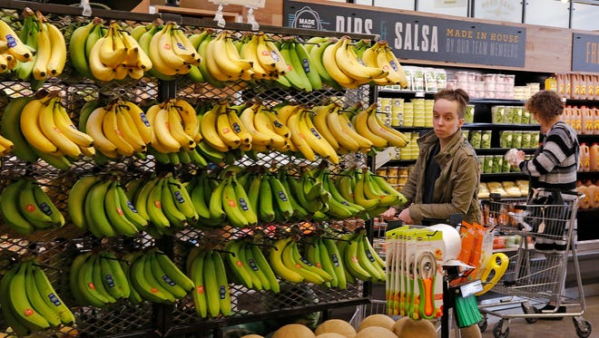 Amazon is  lowering prices on select Whole Foods items, including Whole Trade bananas.
