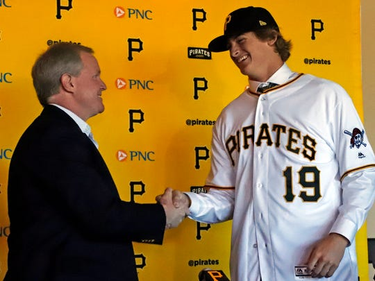 Pittsburgh Pirates first-round draft pick, Quinn Priester, a right-handed pitcher out of Cary-Grove High School in Cary, Illinois, right, shakes hands with Pittsburgh Pirates general manager Neil Huntington after signing with the team at PNC Park in Pittsburgh, Tuesday, June 11.