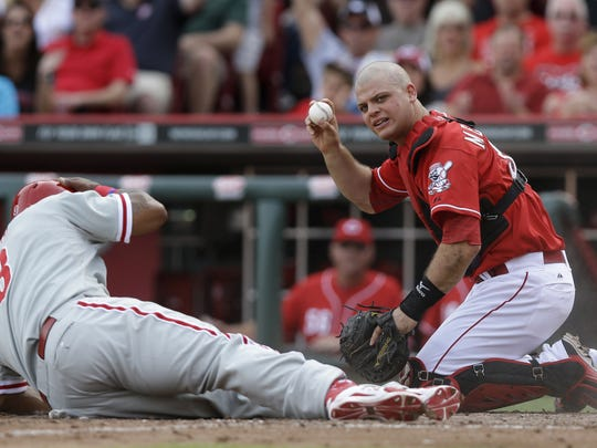 Cincinnati Reds catcher Devin Mesoraco holds up the