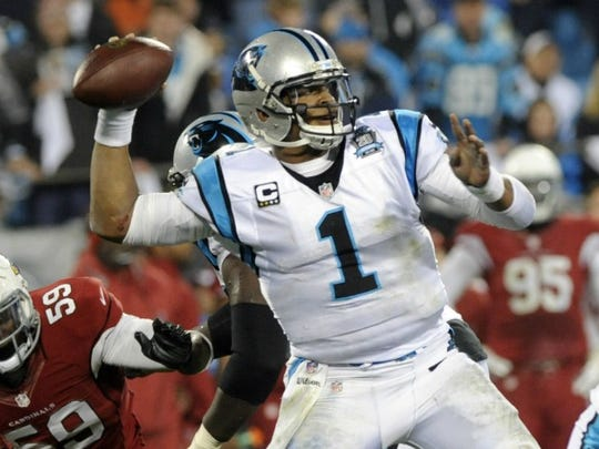 Panthers quarterback Cam Newton (1) looks for a receiver